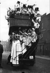 Mary Neal on a Bus with Children in London